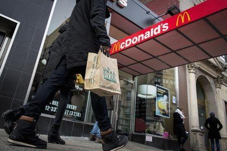 McDonald's to reorganize units, boost franchises in turnaround