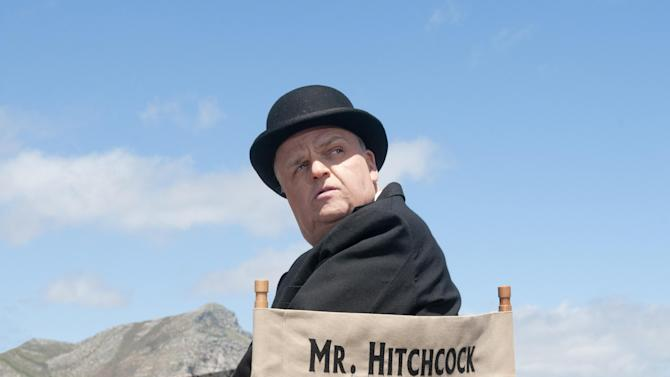 """This image released by HBO shows Toby Jones, portraying Alfred Hitchcock in a scene from the film """"The Girl.""""   """"The Girl"""" was nominated for a Golden Globe for best television movie or miniseries on Thursday, Dec. 13, 2012. The 70th annual Golden Globe Awards will be held on Jan. 13.  (AP Photo/HBO, Kelly Walsh)"""