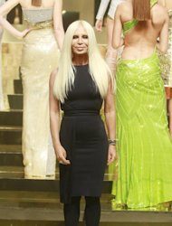 Fashion designer Donatella Versace appears at the end of her Women&#39;s Spring Summer 2012/2013 fashion collection presented in Paris, Monday, Jan. 23, 2012. (AP Photo/ Jacques Brinon)