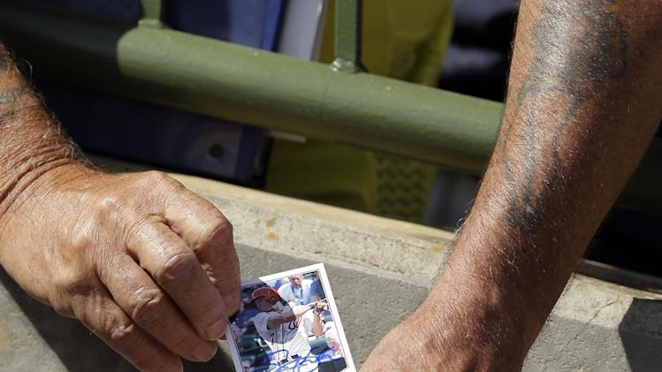 Washington Nationals right fielder Scott Hairston signs a card after batting practice of a spring exhibition baseball game against the Houston Astros in Kissimmee, Fla., Sunday, March 16, 2014. (AP Photo/Carlos Osorio)