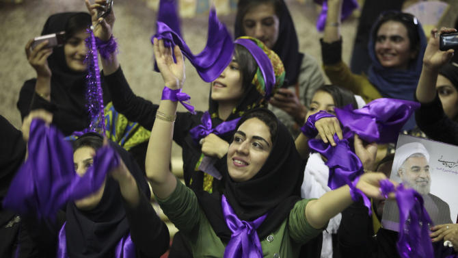 Female supporters of the Iranian Presidential candidate Hasan Rowhani, a former Iran's nuclear negotiator, attend a campaign rally at the western city of Sanandaj, Iran, Monday, June 10, 2013. He talks about easing the political restrictions imposed by Iranian authorities. He told crowds that rebuilding ties with Western governments is better than denouncing them as irreconcilable enemies. At a rally Monday, crowds gathered for candidate Hasan Rowhani broke out in chants for the release of political prisoners. (AP Photo/Vahid Salemi)