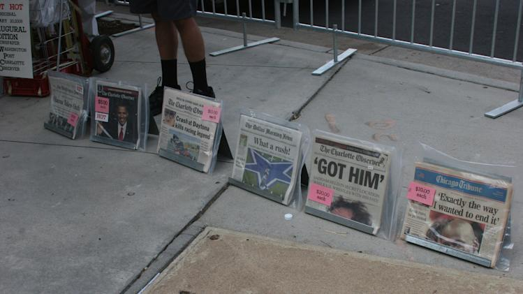 A vendor sells newspapers on Tuesday Sept. 4, 2012 from when Osama bin Laden was killed. (Torrey AndersonSchoepe/Yahoo! News)