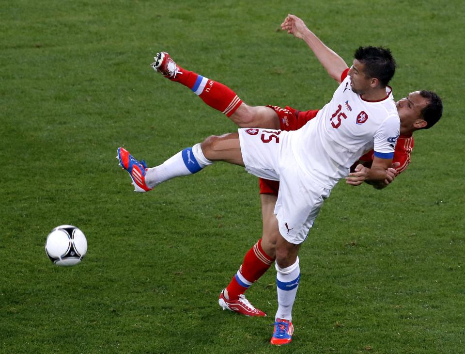 Czech Republic's Milan Baros, front, and Russia's Sergei Ignashevich compete for the ball  during the Euro 2012 Group A soccer match between Russia and Czech Republic, in Wroclaw, Poland, Friday, June 8, 2012.  (AP Photo/Anja Niedringhaus)