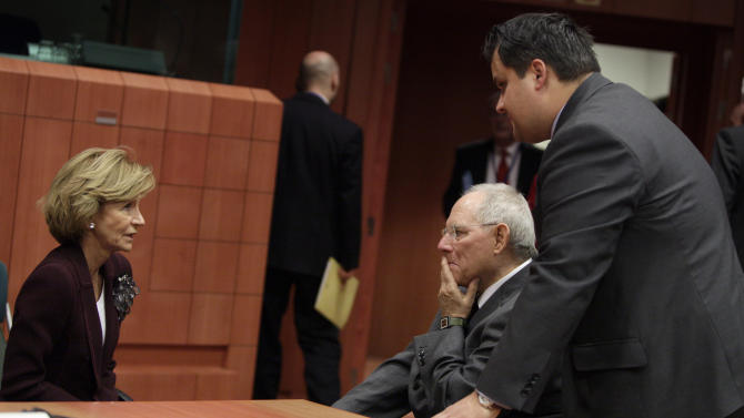 German Finance Minister Wolfgang Schaeuble, second right, speaks with Spain's Finance Minister Elena Salgado, left, and Dutch Finance Minister Jan Kees De Jager during a round table meeting of the eurogroup at the EU Council building in Brussels on Tuesday, Nov. 29, 2011. The 17 finance ministers of countries that use the euro converged on EU headquarters Tuesday in a desperate bid to save their currency and to protect Europe, the United States, Asia and the rest of the global economy from a debt-induced financial tsunami. (AP Photo/Virginia Mayo)