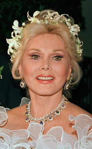 FILE - This Aug. 15, 1986 file photo shows actress Zsa Zsa Gabor on her wedding day in Los Angeles. As the former socialite and actress lies motionless _ unable to eat, barely able to communicate, hardly knowing where she is _ tensions seethe between the two people closest to Gabor: Her husband of 25 years, Frederic Prinz von Anhalt, and her only daughter, Francesca Hilton. (AP Photo/File)