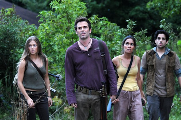 "This image released by NBC shows, from left, Tracy Spiridakos as Charlie Matheson, Billy Burke as Miles Matheson, Daniella Alonso as Nora, and Paras Patel as Albert, in a scene from ""Revolution."" The series by J.J. Abrams tells of a world 15 years after the world inexplicably suffers a power outage. Every gadget, light source, communications means and motor vehicle is the victim of a seemingly permanent blackout. It airs Mondays at 10 p.m. EDT on NBC. (AP Photo/NBC, Brownie Harris)"