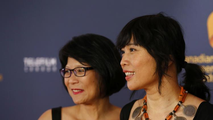Actress Sook-Yin Lee and MP Olivia Chow arrive on the red carpet at the 2014 Canadian Screen awards in Toronto