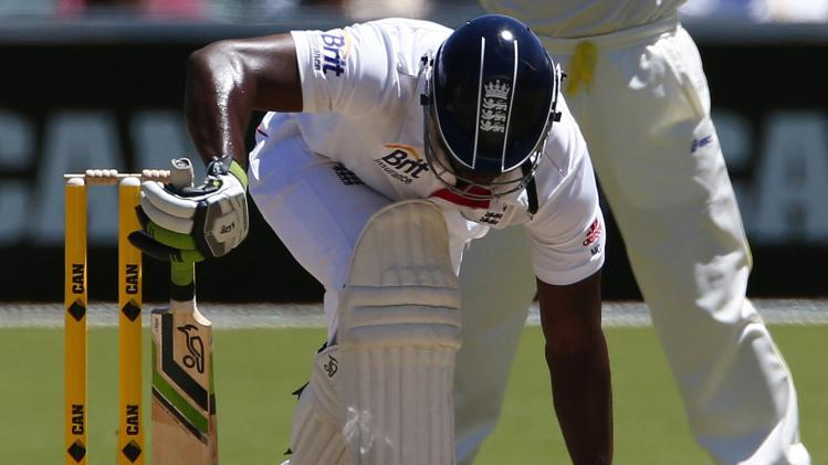 England's Carberry leans on his bat after he misses a shot during the third day of the second Ashes test cricket match against Australia in Adelaide