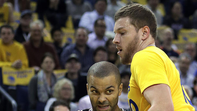 San Antonio Spur's Tony Parker, left, of France, drives the ball past Golden State Warriors' David Lee during the first half of an NBA basketball game, Friday, Feb. 22, 2013, in Oakland, Calif. (AP Photo/Ben Margot)