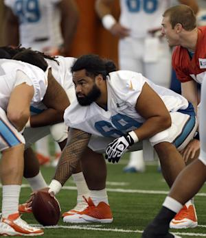 Satele back with Dolphins as stopgap center