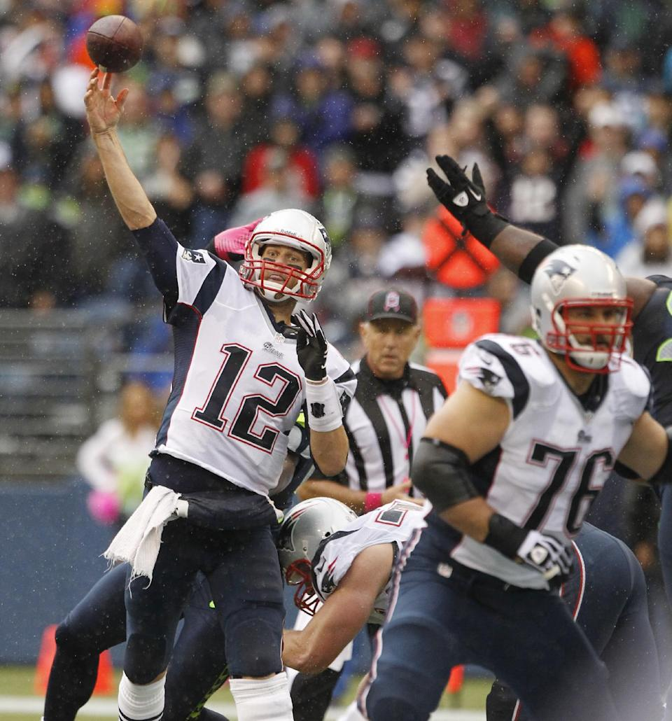 New England Patriots quarterback Tom Brady passes against the Seattle Seahawks in the second half of an NFL football game, Sunday, Oct. 14, 2012, in Seattle. (AP Photo/Elaine Thompson)