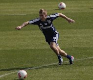 Schalke midfielder Lewis Holtby during a training session in Doha on January 4, 2013. Tottenham have agreed a deal to sign the German under-21 skipper at the end of the season. Holtby had recently confirmed he would be leaving Schalke and Tottenham announced on Friday that the 22-year-old will move to White Hart Lane when his contract with the German club expires in June