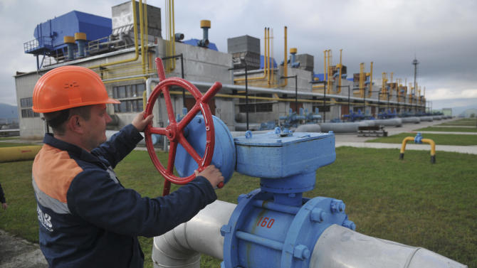 FILE - In this Wednesday, Oct. 7, 2015 file photo, a worker at a Ukrainian gas station Volovets in western Ukraine controls a valve. The Russian state-controlled gas company is halting supplies to Ukraine, its chief executive said Wednesday, Nov. 25, 2015, less than two months after the two countries struck an EU-sponsored deal. Gazprom's CEO Alexei Miller said Russia sent the last shipment to Ukraine at 10 a.m. local time on Wednesday and send no more because Ukraine has not paid in advance for future supplies. (AP Photo/Pavlo Palamarchuk)