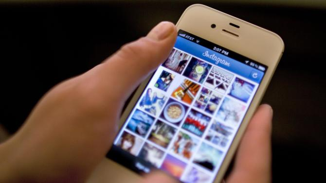 File-This April 9, 2012, file photo shows Instagram being demonstrated on an iPhone in New York. Social media websites Facebook and Instagram  have stopped working Tuesday, Jan. 27, 2015. The problem is affecting users in Australia but also in other  countries including the United States. (AP Photo/Karly Domb Sadof, File)