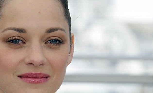 "Cast member Marion Cotillard poses during a photocall for the film ""The Immigrant"" at the 66th Cannes Film Festival"