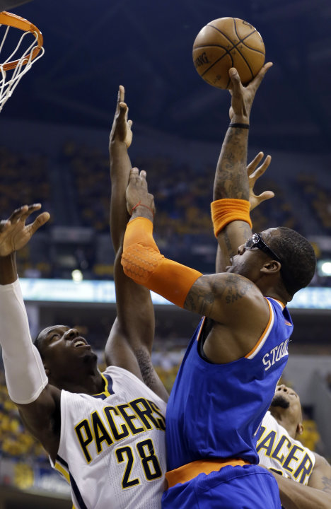 New York Knicks' Amare Stoudemire shoots over Indiana Pacers' Ian Mahinmi (28) during the first half of Game 6 of an Eastern Conference semifinal NBA basketball playoff series Saturday, May 18, 2013,