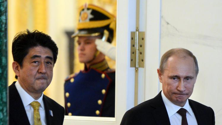 Putin, Japanese leader step up peace treaty effort