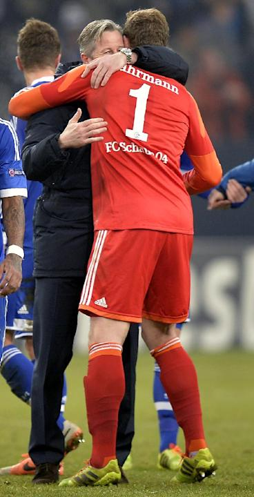 Schalke head coach Jens Keller, left, hugs goalkeeper Ralf Faehrmann after the Champions League Group E soccer match between FC Schalke 04 and FC Basel in Gelsenkirchen, Germany, Wednesday, Dec. 11, 2