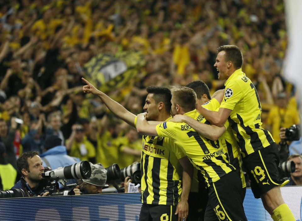 Dortmund's Ilkay Guendogan, centre, reacts with teammates, after scoring his side's first goal, during the Champions League Final soccer match between Borussia Dortmund and Bayern Munich at Wembley Stadium in London, Saturday May 25, 2013. (AP Photo/Kirsty Wigglesworth)