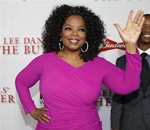 """Actress Oprah Winfrey, a cast member of the film """"Lee Daniels' The Butler"""", poses at the film's premiere in Los Angeles"""