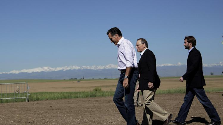 Republican presidential candidate, former Massachusetts Gov. Mitt Romney, center, walks with Kevin Kauffman, CEO and president of KP Kauffman Co., an oil and gas production and drilling company, at a campaign stop in Fort Lupton, Colo.,Wednesday, May 9, 2012. (AP Photo/Jae C. Hong)