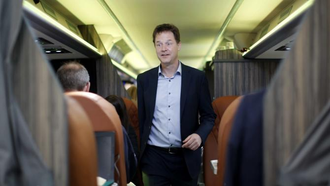 Britain's Liberal Democrat leader Nick Clegg boards his campaign bus after campaigning with local candidate Vince Cable in Twickenham