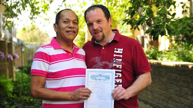 Darren Black Bear, left, and Jason Pickel hold up their marriage license issued by the Cheyenne and Arapaho Tribes near Jason's home in Oklahoma City, Thursday Oct. 24, 2013. Despite Oklahoma's ban on same-sex marriage, the couple will be legally married in the state thanks to Black Bear, who is a member of the Oklahoma-based Cheyenne Arapaho Tribes. It's among the few Native American tribes in the U.S. that allow same-sex marriage. (AP Photo/Nick Oxford)