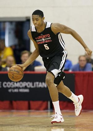 The Toronto Raptors' Bruno Caboclo dribbles the ball up the court against the Dallas Mavericks during an NBA summer league basketball game Monday, July 14, 2014, in Las Vegas