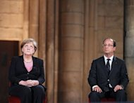 &lt;p&gt;French President Francois Hollande (R) and German Chancellor Angela Merkel attend a ceremony in the Cathedral on July 8, 2012 in the northern French city of Reims, during a day of ceremonies to commemorate the 50th anniversary of renewed Franco-German relations after World War II.&lt;/p&gt;
