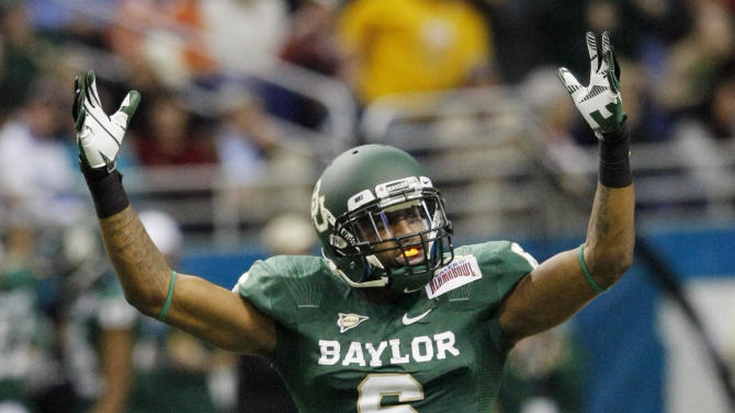 Baylor's Ahmad Dixon celebrates with fans during the second half of the Alamo Bowl college football game against Washington, Thursday, Dec. 29, 2011, at the Alamodome in San Antonio. Baylor pulled out a thrilling Alamo Bowl victory in the highest-scoring bowl game in history, beating Washington 67-56 in a record-smashing shootout Thursday night. (AP Photo/Darren Abate)