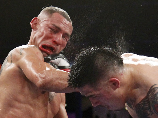 Brandon Rios of the U.S. connects to the face of compatriot Mike Alvarado during the sixth round of their WBO Latino Super Lightweight Title boxing match in Carson, California