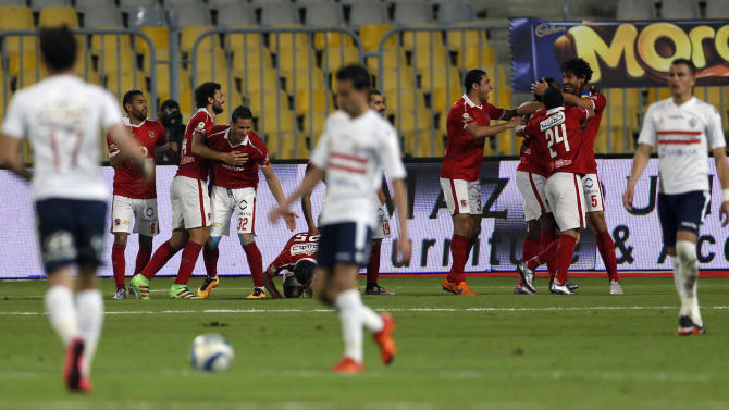 """Al-Ahly's players celebrate the goal of teammate Malick Evouna against El Zamalek during their Egyptian Premier League derby soccer match at Borg El Arab """"Army Stadium"""", west of of Alexandria"""