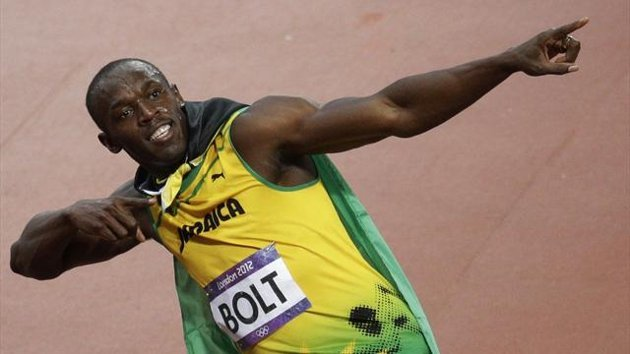 Usain Bolt celebrates winning Olympic 100m final in London