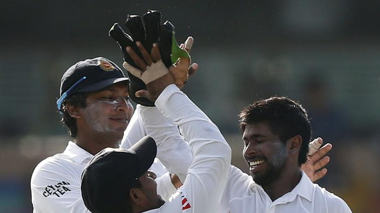 Sri Lanka's wicketkeeper Dickwella celebrates with teammates after taking the catch to dismiss South Africa's du Plessis during the second day of their second test cricket match in Colombo