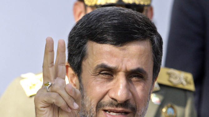 FILE - In this Sept. 1, 2012, file photo, Iranian President Mahmoud Ahmadinejad flashes a victory sign in Tehran, Iran. With the Iraq war over and Afghanistan winding down, Iran is the most likely place for a new U.S. military conflict. Despite unprecedented global sanctions, Iran's nuclear program is advancing. The United States and other Western nations fear the Islamic republic is determined to develop nuclear weapons and fundamentally reshape the balance of power in the Middle East, while posing a grave threat to Israel. Iran insists its program is solely designed for peaceful energy and medical research purposes.   (AP Photo/Vahid Salemi, File)