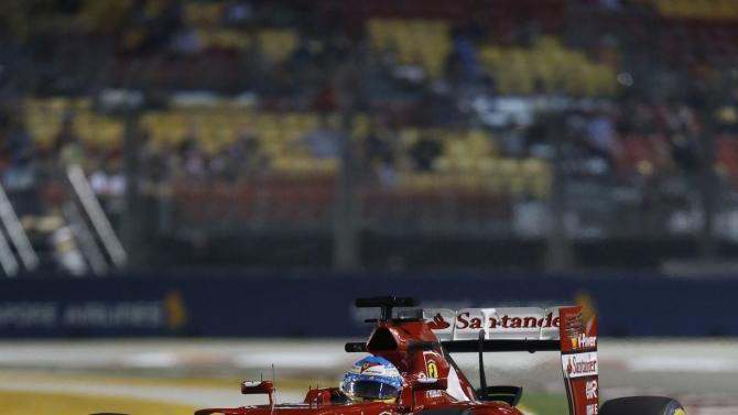 Ferrari Formula One driver Alonso of Spain drives during the second practice session of the Singapore F1 Grand Prix at the Marina Bay street circuit in Singapore