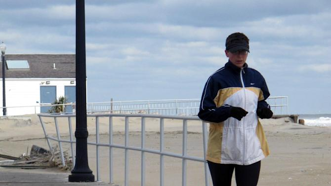 In this Nov. 15, 2012 photo, a jogger runs on a storm-damaged section of the Bradley Beach, N.J., boardwalk. Coastal towns are racing to rebuild their boardwalks from Superstorm Sandy's damage in time for next summer. (AP Photo/Wayne Parry)