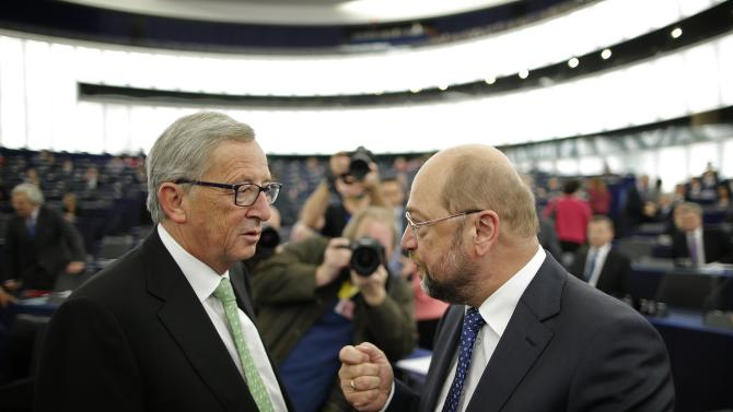 Jean-Claude Juncker, the incoming president of the European Commission, talks with Schulz, president of the European Parliament, before the presentation of the college of Commissioners and their program at the EU Parliament in Strasbourg