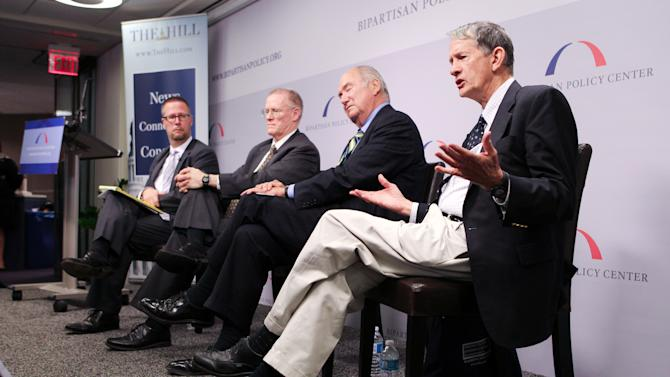 """COMMERCIAL IMAGE - In this photograph taken by AP Images for Peterson Institute for International Economics, Gary Hufbauer, Senior Fellow, Peterson Institute for International Economics, on right, participates in a breakfast panel at the Bipartisan Policy Institute discussing the """"Five Key Issues that Will Decide the Election"""" on Thursday, August 2, 2012 in Washington.  (Paul Morigi/AP Images for Peterson Institute for International Economics)."""