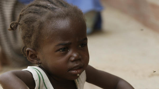 A child rescued by Nigerian soldiers waits to receive treatment at a refugee camp in Yola, Nigeria Sunday, May 3, 2015, after being rescued from captivity by Boko Haram fighters. Their faces were gaunt with signs of malnutrition but the girls are alive and free, among a group of 275 children and women rescued by the Nigerian military, and the first to arrive at a refugee camp Saturday after a three-day journey to safety. They came from the Sambisa Forest, thought to be the last stronghold of the Islamic extremists, where the Nigerian military said it has rescued more than 677 girls and women and destroyed more than a dozen insurgent camps in the past week.( AP Photo/Sunday Alamba)