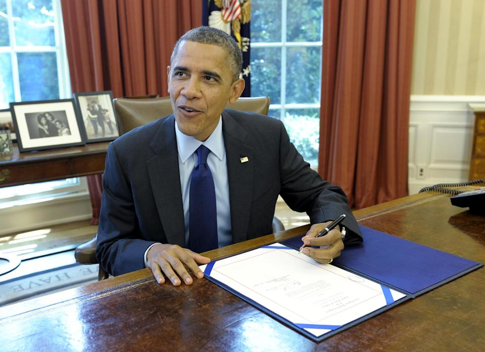 President Barack Obama talks in the Oval Office of the White House in Washington, Wednesday, June 3, 2012, prior to signing the Contract Awards for Large Air Tankers. The bill will support the ability to fight wildfires by enabling the Forest Service to accelerate the contracting of the next generation of air tankers for wildfire suppression.  (AP Photo/Susan Walsh)