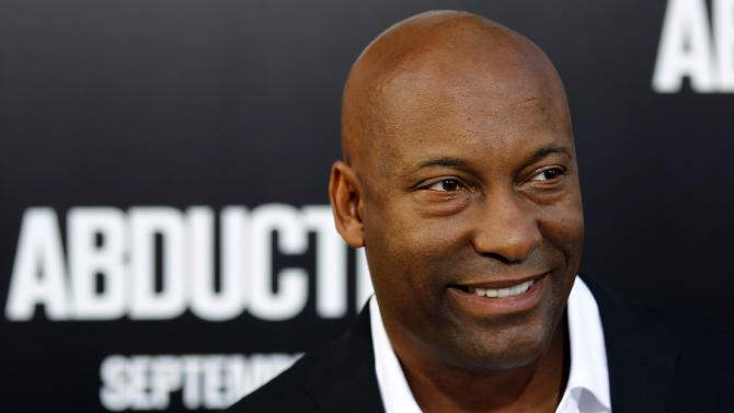 """FILE - In this Sept. 15, 2011 file photo, director John Singleton arrives at the premiere of """"Abduction"""" in Los Angeles.  Court records show Singleton and Paramount Pictures on Nov. 1, 2012 settled a lawsuit filed by the director/producer that claimed the studio reneged on a contract to allow his company to produce two additional films after the release of 2005's """"Hustle & Flow,"""" which received two Oscar nominations. (AP Photo/Matt Sayles, file)"""