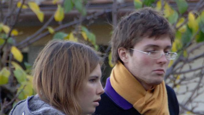 FILE - This Nov. 2, 2007 file photo shows Amanda Marie Knox, of the U.S., left, and her then-boyfriend Raffaele Sollecito, of Italy, outside the rented house where 21-year-old British student Meredith Kercher was found dead in Perugia, Italy. The Court of Cassation on Monday March 25, 2013 is considering prosecutors' contentions that the 2011 acquittals of American Knox and her Italian ex-boyfriend in the murder of British student Meredith Kercher should be thrown out and a new trial ordered. (AP Photo/Stefano Medici, File)