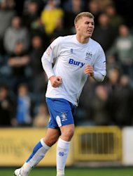 Andy Bishop has returned to Bury following a period away on loan at Wrexham