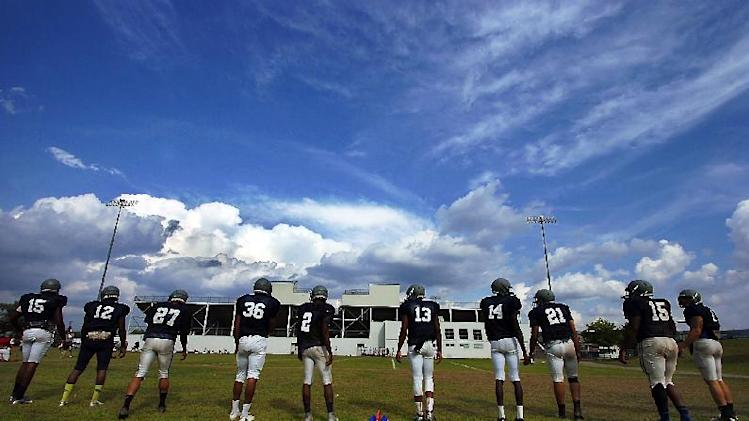 Lackawanna College football players stand in line during NCAA college football practice drills on Thursday, Aug. 21, 2014, at Scranton High School in Scranton, Pa. (AP Photo / The Scranton Times-Tribune, Butch Comegys)