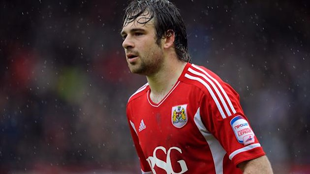 Brett Pitman has completed a return to Bournemouth