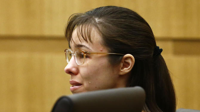 "FILE - Jodi Arias cries as Steven Alexander, brother of murder victim Travis Alexander, makes his ""victim impact statement"" to the jury in this Thursday, May 16, 2013 file photo, during the penalty phase of the Jodi Arias trial at Maricopa County Superior Court in Phoenix. Arias returns to court Monday May 20, 2013 for the continuation of her trial after being convicted of murder in her lover's killing as jurors consider a life sentence or execution. (AP Photo/The Arizona Republic, Rob Schumacher, File)"