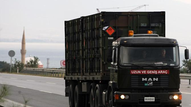 A Turkish military truck carrying NATO's Dutch Patriot Missile Defense System to protect Turkey in case neighboring Syria launches an attack leave the the Mediterranean port city of Iskenderun, Turkey, Tuesday, Jan. 22, 2013. The Dutch Patriot Systems and troops were heading for Adana to prepare to operate a defensive missile system close to the border with Syria. (AP Photo / Burhan Ozbilici)