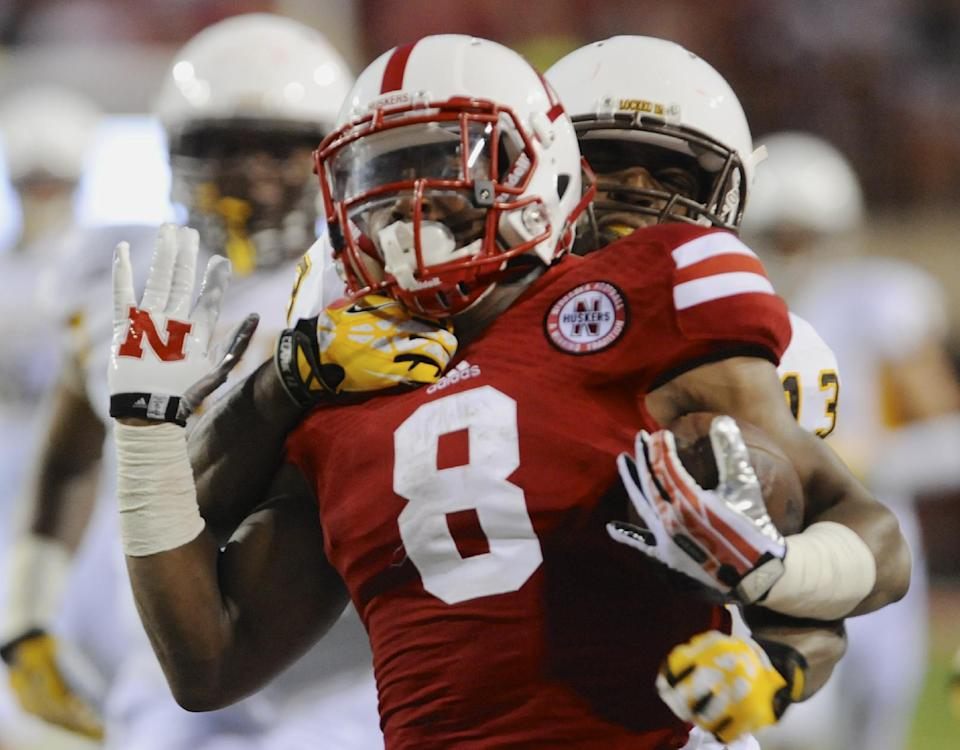 No. 18 Nebraska holds off Wyoming 37-34 in opener