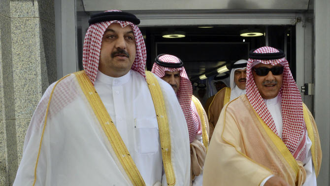 Qatari Foreign Minister Khalid bin Mohammed al-Attiyah, left, arrives to attend a meeting of Gulf foreign ministers in Jeddah, Saudi Arabia, Saturday Aug. 30, 2014. The meeting of Gulf foreign ministers ended on Saturday without a clear way out of a monthslong diplomatic spat with Qatar, although some envoys signaled that progress had been made. Saudi Arabia, along with the United Arab Emirates and Bahrain, withdrew their ambassadors from Qatar in March in an unprecedented public protest largely believed to be spurred by the tiny nation's support for Islamist groups in Egypt, Libya, the Gaza Strip and elsewhere. (AP Photo/Saudi Press Agency)